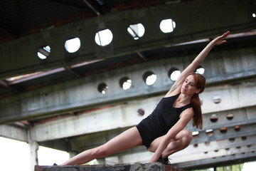 fit woman exercising t in postindustrial environment