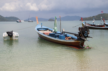 Thai traditional wooden boat  in Panwa bay, Phuket, Thailand