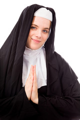 Young nun welcoming with hands clasped