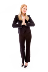 Businesswoman greeting with hands clasped