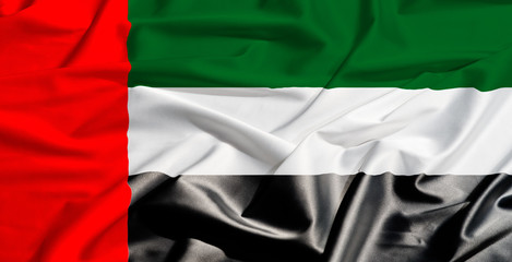 Emirates flag on a silk drape waving
