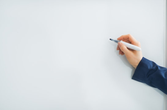 Closeup on business woman writing in flipchart