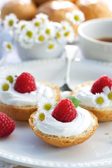 Butter buns with  creamy cheese and fresh raspberries