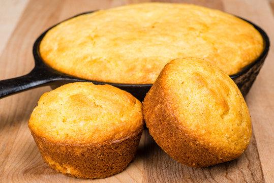 Cornbread muffins and cornbread pone in an iron skillet