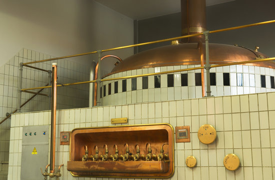 Mash tun and wort siphoning valves in brewery.