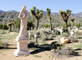 Mother Mary Statue In Desert Cemetery