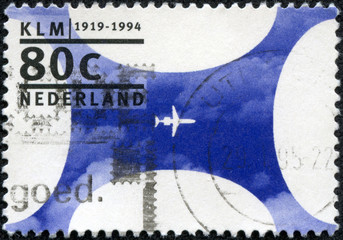 stamp printed in the Netherlands shows KLM, Royal Dutch Airlines