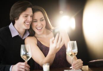 Couple Taking Selfie Through Smart Phone At Nightclub