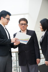 asian business executive presenting chart to CEO