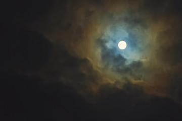 Full moon on dramatic cloudy sky