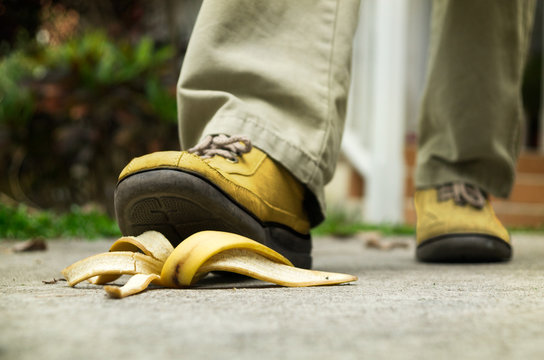man stepping on banana peel