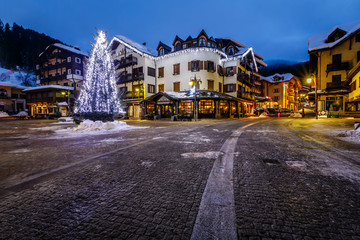 Wall Mural - Illuminated Central Square of Madonna di Campiglio in the Mornin