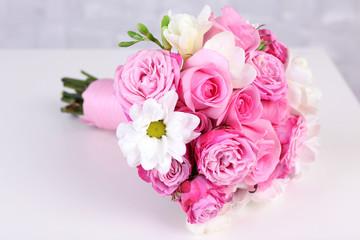 Beautiful wedding bouquet on grey wall background