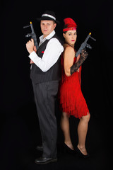 Dangerous bonny and clyde gangster with 1920 style clothes stand