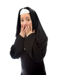 Young nun looking scared