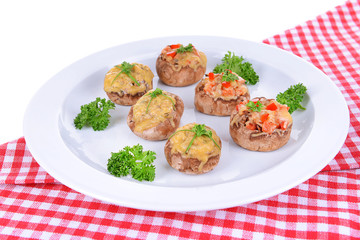 Stuffed mushrooms on plate on table close-up
