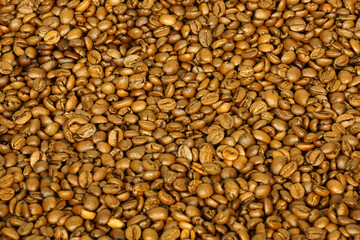 golden coffee beans for background and texture