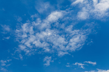 Set of white clouds over blue