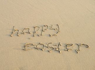 Happy easter written on a sand
