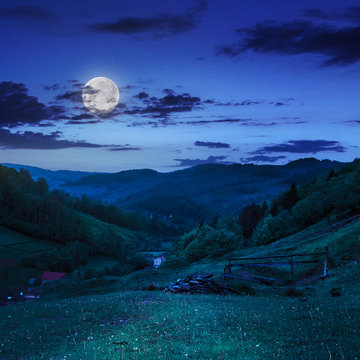 fence in mountains  on hillside  near village at night