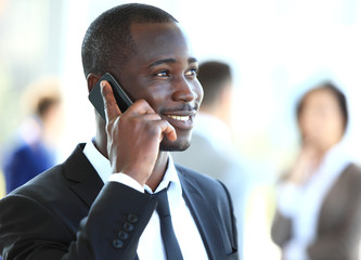 handsome african american businessman talking on mobile phone