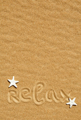 Word relax and seashells on the sand