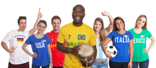 Brazilian football fan with drum and fans from other countries