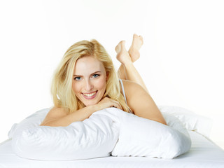 Sexy woman lies in bed