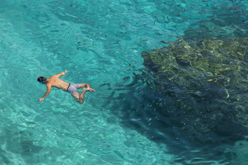 Unrecognizable man snorkeling in water in Lefkada, Greece