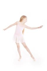 girl dancing in pink ballet suit in studio