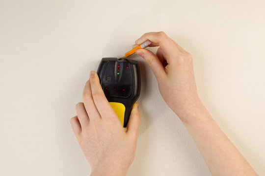 Using Stud Finder on interior home wall