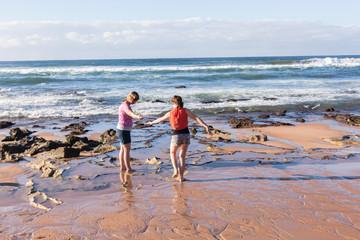 Girls Exploring Marine Life Beach Ocean