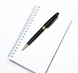 Notebook with a pen