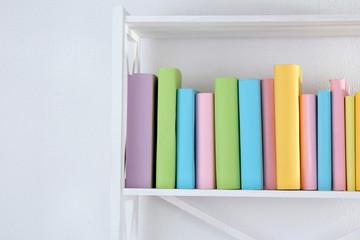 Books on white shelves in room