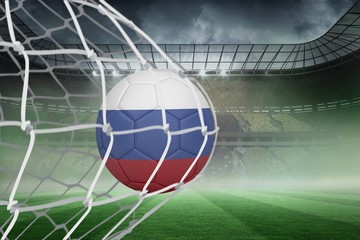 Football in russia colours at back of net