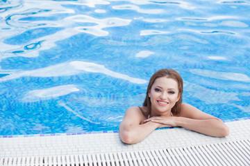 9c75dfdc787a5 Beautiful woman in hotel swimming pool