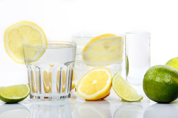 Drink with lime and lemon in three different glasses