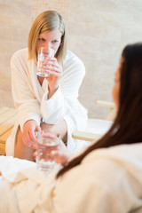Women drink water at beauty spa
