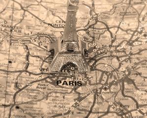 Retro Eiffel Tower on a map of Paris