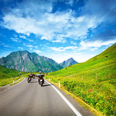 Fototapete - Motocyclists on countryside in mountains