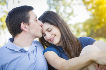 Young Attractive Couple Smooching in the Park