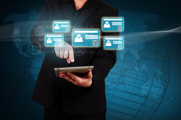 Wall Mural - Businessman holding a tablet with virtual  card and community ic