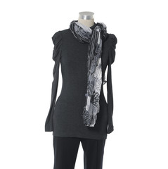 female shirt dress with scarf and trousers isolated on a dummy