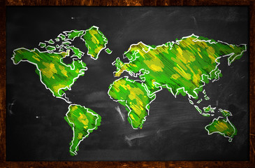 Green World Map Sketch On Blackboard