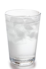 Detail of a simple glass of water with floating ice cubes