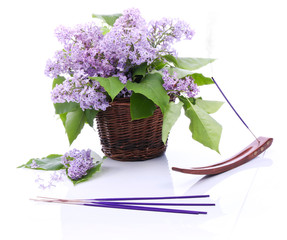 Fototapeta Lilac bouquet in a wicker basket and incense set obraz