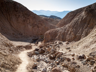 Dry creek passing through hills, Death Valley National Park, Cal