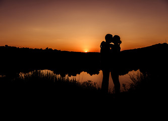 romantic sunset couple silhouettes