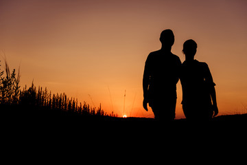 sunset couple silhouettes