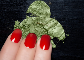 Red Nail Polish and Mineral Green Eye Shadow